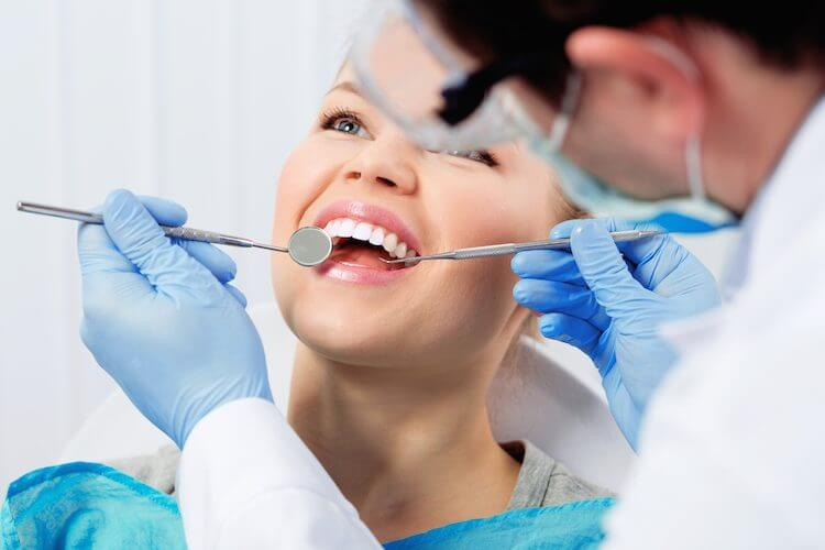 dentist examinig patient